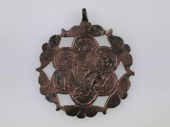 Medalla. Cigne, envoltat d'una decoració d'aus, gossos i aglans