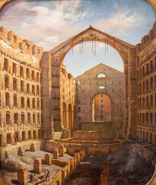 L'interior del Liceu després del gran incendi de 1861. Destaca la vista del soterrani i l'escenari, així com les parets laterals, que no es fan esfondrar